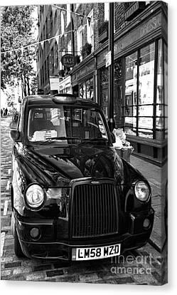 London Taxi Canvas Print by John Rizzuto