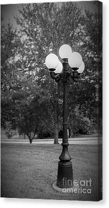 Lonely Lamp Post Canvas Print by Christina Stanley