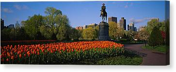 Low Angle View Of A Statue In A Garden Canvas Print by Panoramic Images