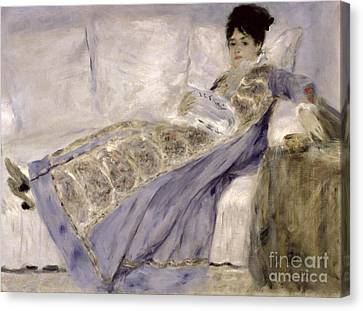 Madame Monet On A Sofa Canvas Print by Pierre Auguste Renoir