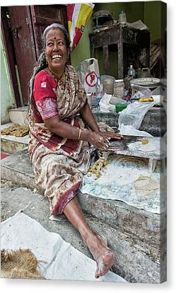 Making Chapatti Canvas Print by Marion Galt