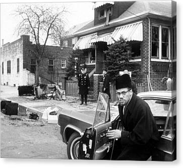 Malcolm X, Returns Home After His House Canvas Print by Everett