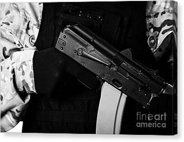 Man In Combat Fatigues And Bullet Proof Jacket Holding Aks-47u Close Quarter Combat Kalashnikov Rifl Canvas Print by Joe Fox