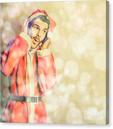 Man In Santa Costume Listening To Christmas Songs Canvas Print by Jorgo Photography - Wall Art Gallery