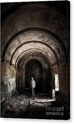 Man Inside A Ruined Chapel Canvas Print by Carlos Caetano