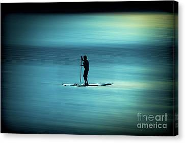 Man Paddling Board On Lake Sun Setting Canvas Print by Dan Friend