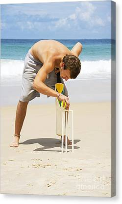 Man Playing Beach Cricket Canvas Print by Jorgo Photography - Wall Art Gallery