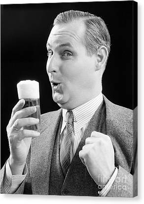 Man With Glass Of Beer, C.1930s Canvas Print by H. Armstrong Roberts/ClassicStock