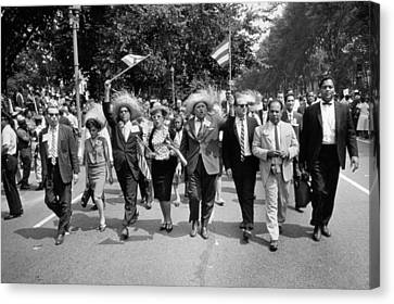 Marchers Wearing Hats Carry Puerto Rican Flags Down Constitution Avenue Canvas Print by Nat Herz