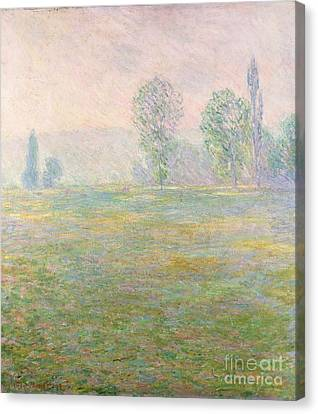 Meadows In Giverny Canvas Print by Claude Monet