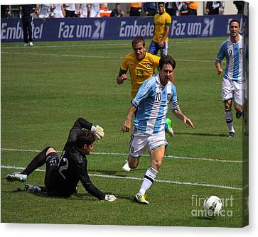 Messi Breaking Ankles Canvas Print by Lee Dos Santos