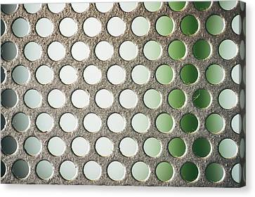 Metal Plate With Many Small Circular Holes Macro Texture Background Canvas Print by Eduardo Huelin