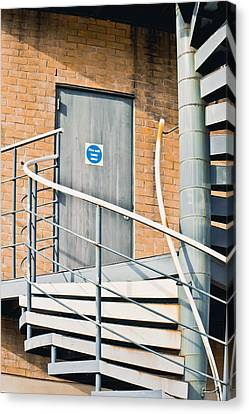 Metal Staircase Canvas Print by Tom Gowanlock