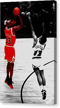 Michael Jordan Over John Stockton Canvas Print by Brian Reaves