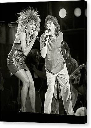 Mick And Tina At Live Aid 1985 Canvas Print by Chuck Spang