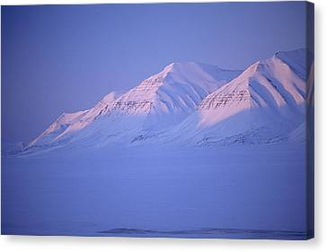 Midnight Sunset On Polar Mountains Canvas Print by Gordon Wiltsie