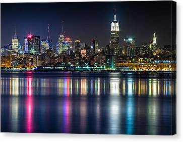Midtown Manhattan From Jersey City At Night Canvas Print by Val Black Russian Tourchin