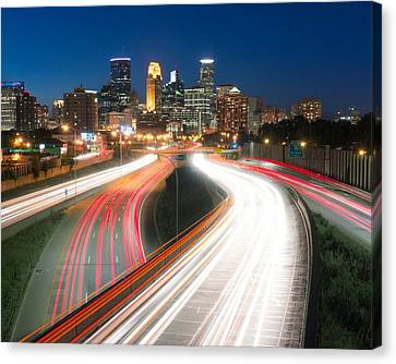 Minneapolis Skyline And Traffic Flow Canvas Print by Jim Hughes