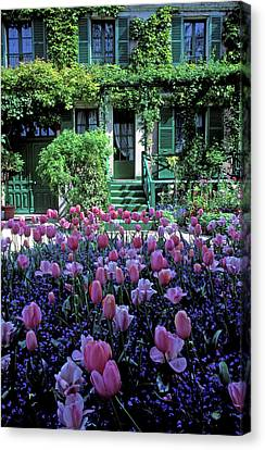 Monet's House With Tulips Canvas Print by Kathy Yates