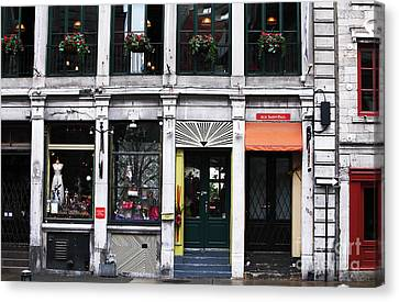 Montreal Shops Canvas Print by John Rizzuto