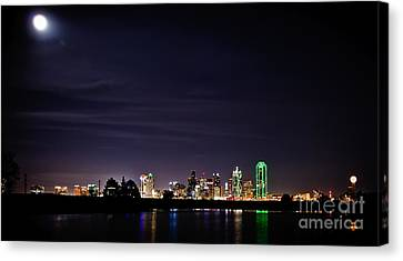 Moon Over Dallas Canvas Print by Charles Dobbs