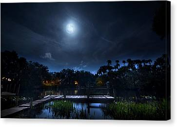 Moon Over The River Canvas Print by Mark Andrew Thomas
