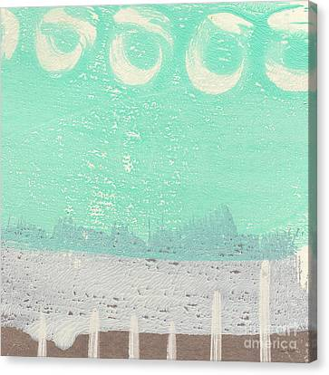 Moon Over The Sea Canvas Print by Linda Woods