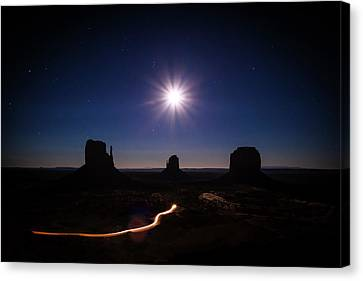 Moonlight Over Valley Canvas Print by Edgars Erglis