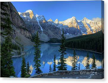 Moraine Lake Sunrise Blue Skies Canvas Print by Wayne Moran
