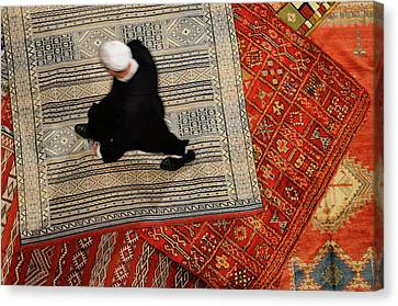 Morrocan Riad Owner Shopping For A New Persian Rug In Fes El Bal Canvas Print by Reimar Gaertner