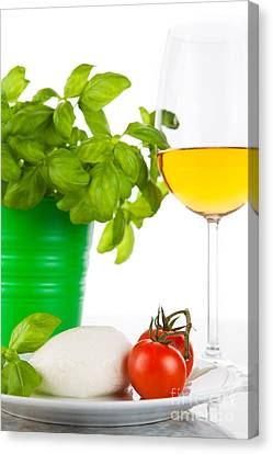 Mozzarella With Tomatoes Basil And Wine Canvas Print by Wolfgang Steiner