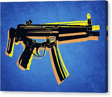 Mp5 Sub Machine Gun On Blue Canvas Print by Michael Tompsett