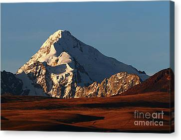 Mt Huayna Potosi And Altiplano Canvas Print by James Brunker