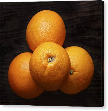 Naval Oranges On Wood Background Canvas Print by Donald Erickson