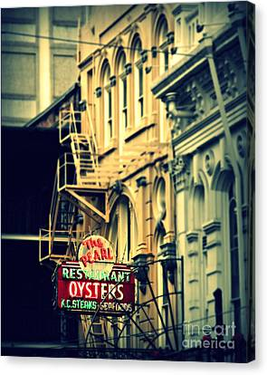 Neon Oysters Sign Canvas Print by Perry Webster