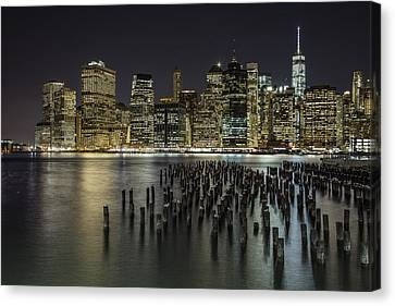 New York And Pier  Canvas Print by John McGraw