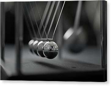 Newton's Cradle In Motion - Metallic Balls Canvas Print by N.J. Simrick