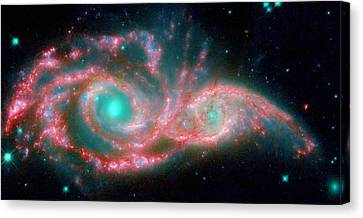 Ngc 2207 And Ic 2163 In The Canis Major Constellation Canvas Print by American School