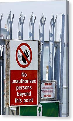 No Unauthorised Persons Sign. Canvas Print by Mark Williamson