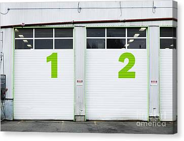 Numbers On Repair Shop Bay Doors Canvas Print by Don Mason