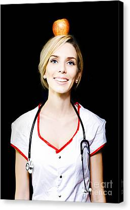 Nurse With The Concept Of A Healthy Balanced Diet Canvas Print by Jorgo Photography - Wall Art Gallery