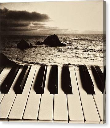 Ocean Washing Over Keyboard Canvas Print by Garry Gay