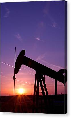 Oil Rig At Sunset Canvas Print by Connie Cooper-Edwards