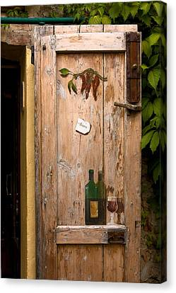 Old Door And Wine Canvas Print by Sally Weigand