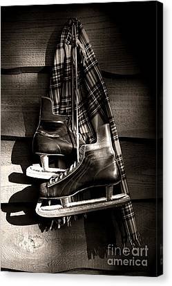 Old Hockey Skates With Scarf Hanging On A Wall Canvas Print by Sandra Cunningham