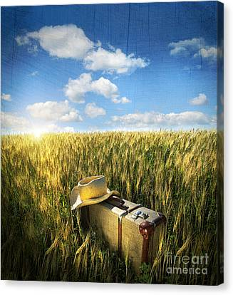 Old Suitcase With Straw Hat In Field Canvas Print by Sandra Cunningham