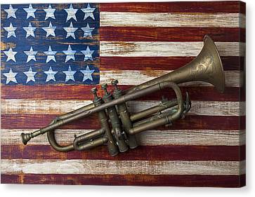 Old Trumpet On American Flag Canvas Print by Garry Gay