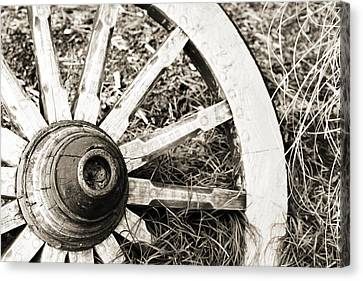 Old Wagon Wheel Canvas Print by Marilyn Hunt