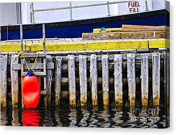 Old Wooden Pier In Newfoundland Canvas Print by Elena Elisseeva