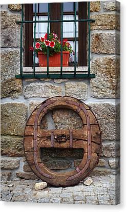Old Wooden Wheel Canvas Print by Carlos Caetano